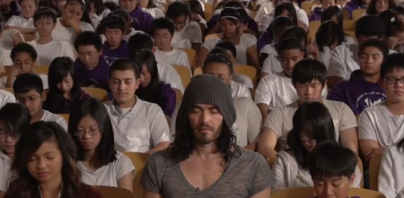 Russell Brand meditates with students in a San Francisco School