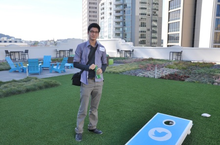Khongor Enkhbold at Twitter headquarters. Note the logoed lawn game and color-coordinated deck furniture.