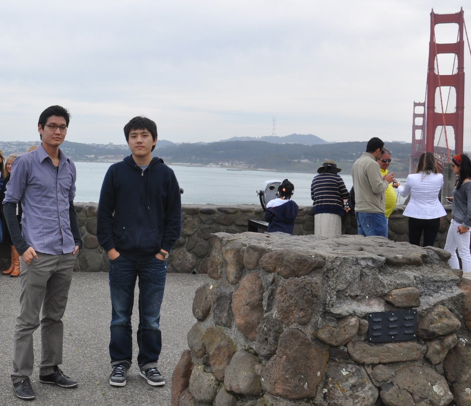 Khonger Enkhbold and Khasan Bold have their picture taken by San Francisco's Golden Gate Bridge during their trip to high-tech companies.