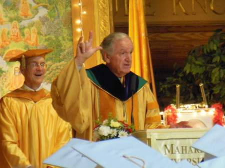 "Iowa Sen. Tom Harkin, right, gives the sign language symbol for ""I love you"" during his commencement address Saturday afternoon inside the Maharishi Patanjali Golden Dome of Pure Knowledge at Maharishi University of Management. Also pictured is M.U.M. vice president Craig Pearson."