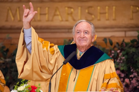"Iowa Senator Tom Harkin gave the sign language symbol for ""I love you"" after his commencement address at Maharishi University of Management."