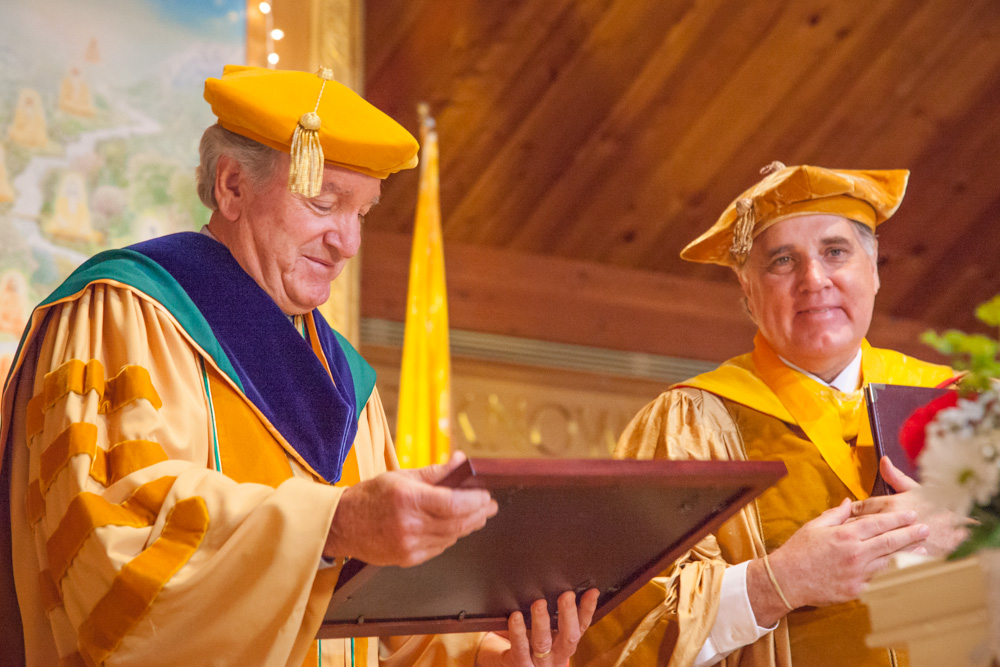 Senator Tom Harkin receives an honorary doctoral degree from M.U.M. President Dr. Bevan Morris.