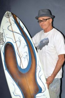 Lanny Shuler with a sample of his surfboard art.