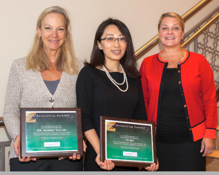 Tabitha Dubois (right), LEI's Director of Finance and Administration, gave the Lean Accounting Student Award to MUM's Ye Shi, and the Lean Accounting Professor Award to WWU's Dr. Audrey Taylor.