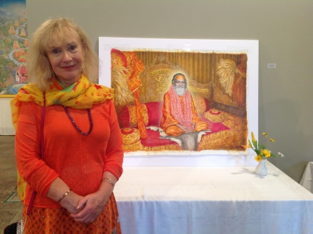 Artist Frances Knight stands in front of her latest painting of Guru Dev, Maharishi's master. Photo taken by Ken Chawkin at ArtFiftyTwo in Fairfield, Iowa