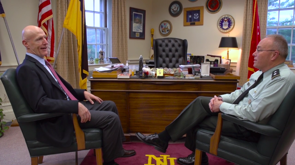 TM teacher Dave Zobeck and Norwich University President Dr. Richard Schneider .png