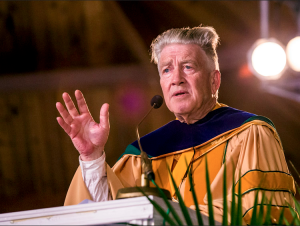 Cody Weber/ for The Hawk Eye Filmmaker David Lynch speaks Saturday at Maharishi University of Management in Fairfield. Lynch was featured and feted at the 41st commencement ceremony with graduates from 53 countries in attendance.
