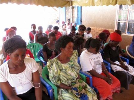 Ugandan women meditate together